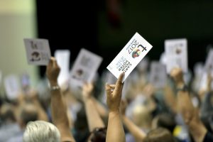 Delegates hold up voting cards at national convention 2017