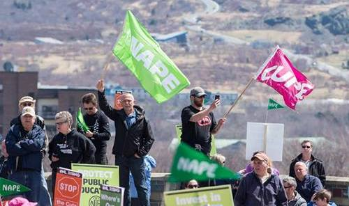 NAPE an CUPE flags at a rally