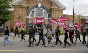 CUPE 1349 members carry flags at march in front of town hall in Grand Falls-Windsor